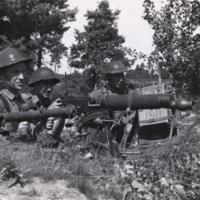 C.O.T.C. soldiers training on machine guns