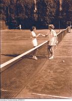 Intercollegiate Women's Tennis, players shakes hand at the net