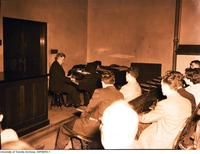Sir Ernest Macmillan playing piano at a meeting of the Medical  Arts and Letters Club held at the Banting Institute.
