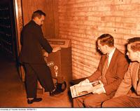 PHE student using automatic shoe shine at Hart House