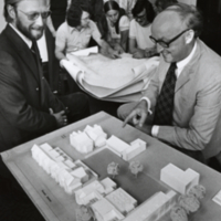 Arthur Hill and Peter Russell look over model for Innis College
