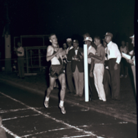 Bruce Kidd wins 6 mile race at the 1962 British Empire Games Trials.