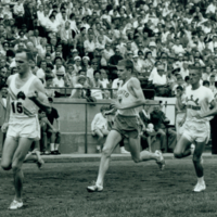 Australian Pat Clohessy, Bruce Kidd, Charlie ?, Chris Williamson in a race at the C.N.E. Labour Day Invitational Meet, T...