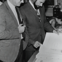 William Dean and ? Matthews look over the Econonic Atlas of Ontario?