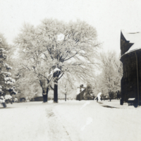 View Past Round Tower - winter scene on campus