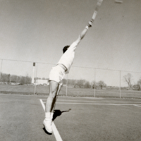 UTM, man serving ball playing tennis