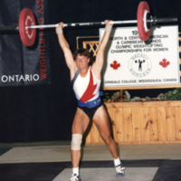 UTM, woman lifting weights at North, Central American and Caribbean Olympic Weightlifting Championships for Women (199?)