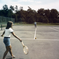 Two people playing tennis at Erindale Campus