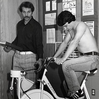 UTM, instructor aiding student on stationary bike