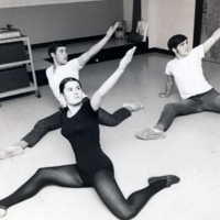 Three students in dance poses