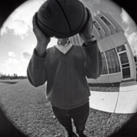 Erindale College (UTM), North Building, distorted view of man holding up basketball