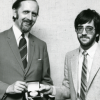 UTM, E.A. Robinson (right) presenting award to unidentified individual