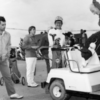 UTM, Principal's Golf Tournament, Paul W. Fox (in golf cart) and Ed Scarlett with unidentifed people
