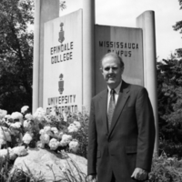 Erindale College (UTM), Robert McNutt standing in front of main entrance sign