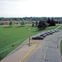UTM, parked cars by a field