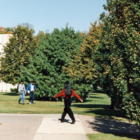 Students walk along pathway to North Building