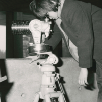 Young visitor looking through Planetarium/Telescope