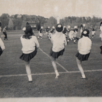 Women's Cheerleading Team at a Football Game