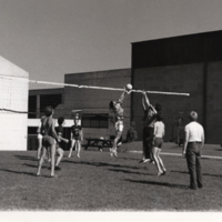 Students Playing Volleyball Outside of Recreation Wing