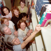 Library staff with last book to be kept in Bladen library, Scarborough Campus