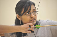 Portrait; female with archery bow, University of Toronto at Scarbrough (UTSC)