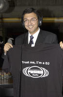 "Opening ceremony, David Naylor, President of the University of Toronto holding a tshirt from UTSC radio that says ""..."