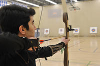 Portrait; male with archery bow and target, University of Toronto at Scarbrough (UTSC)