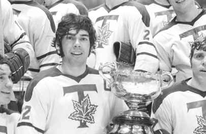 Brian St. John of University of Toronto Blues hockey team holding the Queen's Cup, 1970, from the Robert Lansdale Photographic collection